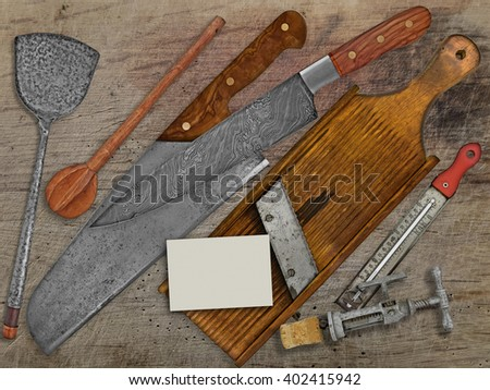 vintage set for cooking over wooden table, space on business card for your text - stock photo