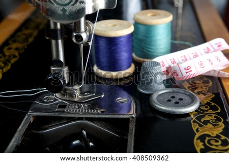 Vintage sewing machine with utensils  - stock photo