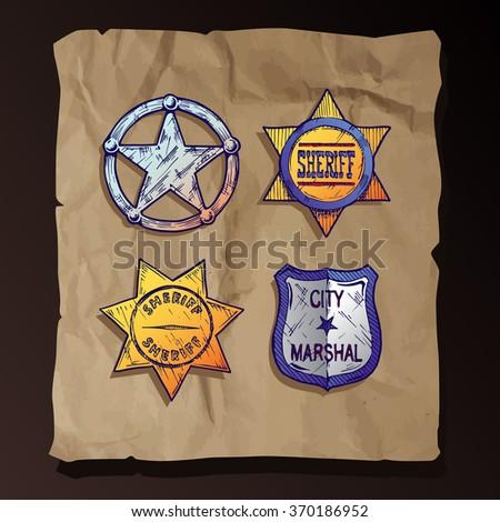 Vintage sheriff stars and marshal badges set on old paper background. - stock photo