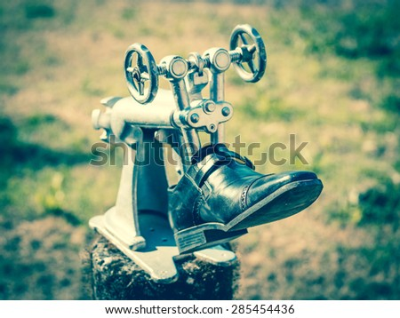 Vintage shoemaker tool - stock photo