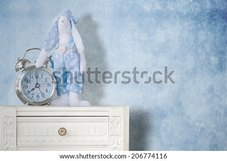 vintage side table with rabbit - stock photo