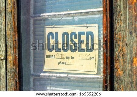 Vintage sign 'Closed' on the old wooden door - stock photo