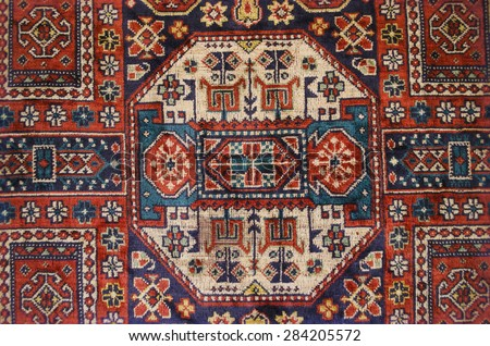 Vintage silky thin carpet with ethnic pattern - stock photo