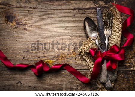 Vintage silverware decorated with red ribbon