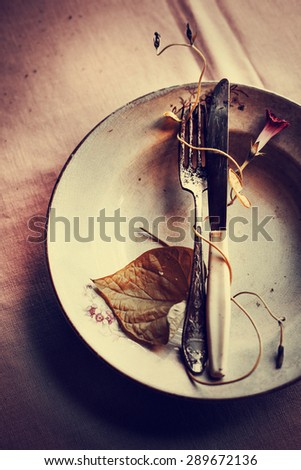 Vintage silverware on rustic wooden background - stock photo