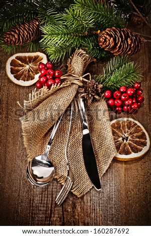 Vintage silverware on rustic wooden background with christmas decoration - stock photo