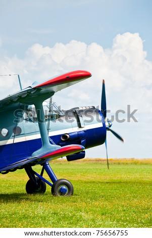 Vintage single-engine biplane aircraft ready to take off - stock photo