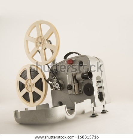 Vintage single metal Overhead Projector 16 mm over gray background Closeup Studio shot object Copy space for inscription Old fashion video legged device Museum exhibit - stock photo