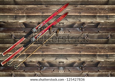 Vintage Ski fixed on wooden wall background - stock photo