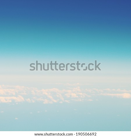 Vintage sky texture. View from the airplane window. Photo processed in retro style. - stock photo