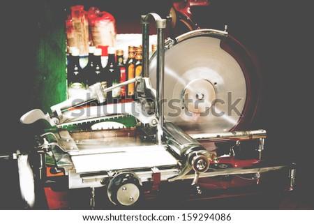 vintage slicer in a restaurant - stock photo