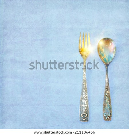Vintage spoon and fork on grunge background - stock photo