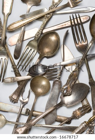 Vintage spoons, forks and knifes - stock photo