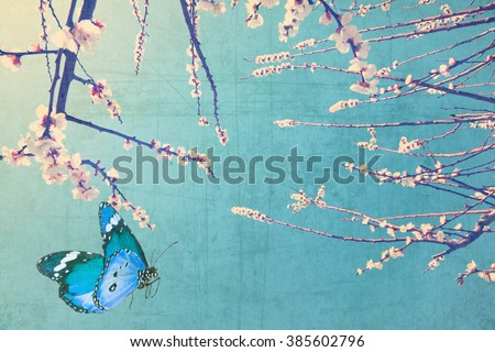 Vintage spring image with blossoming fruit tree and butterflies against blue sky. Springtime nature glitter sparkle. Textured old paper background with conceptual springtime image  - stock photo