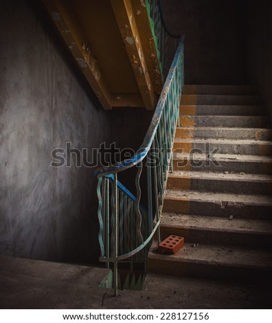 Vintage staircase and dirty floor in abandoned building interior. - stock photo