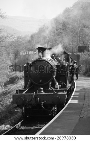 vintage steam train photographed in black and white
