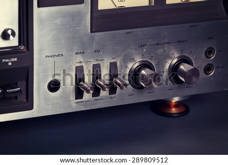 Vintage stereo cassette tape deck player buttons knobs - stock photo