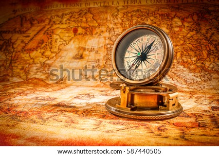 Vintage still life vintage compass lies imagen de archivo stock vintage compass lies on an ancient world map in 1565 gumiabroncs Image collections