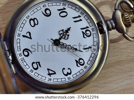 Vintage still life with ancient silver pocket watch
