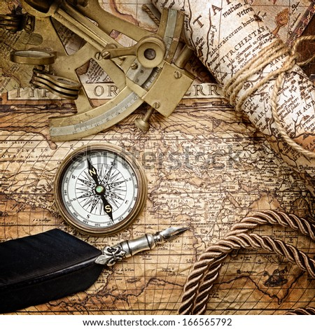 vintage still life with compass,sextant and old map . - stock photo