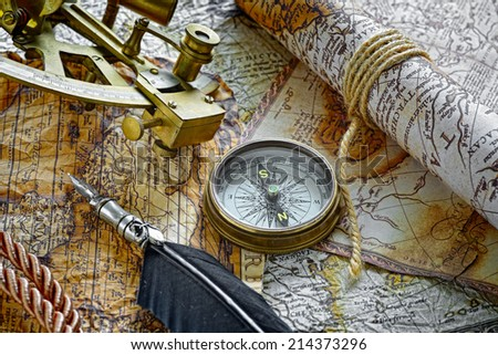 vintage  still life with compass,sextant and old map - stock photo