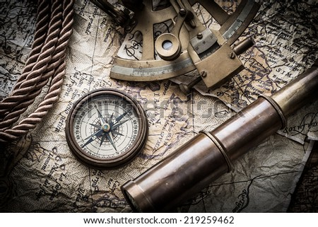 vintage  still life with compass ,sextant ,spyglass ,and old map. - stock photo