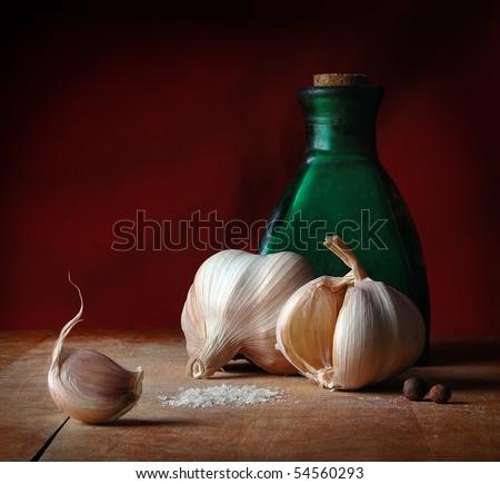 Vintage still life with garlic, salt and allspice - stock photo