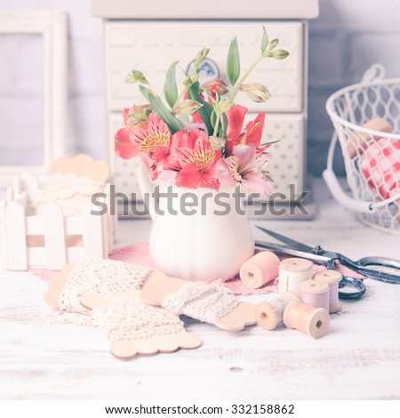 Vintage still life with handcraft materials and flowers
