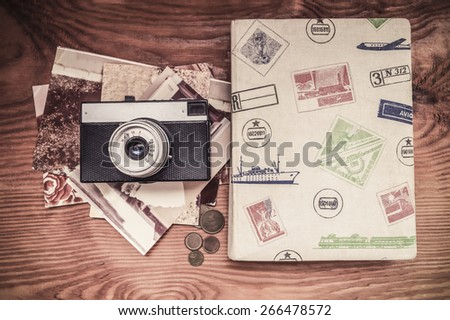 Vintage still life with old camera - stock photo