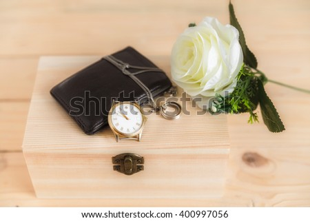 Vintage still life with watch and wallet and ring on a wooden box-soft color - stock photo