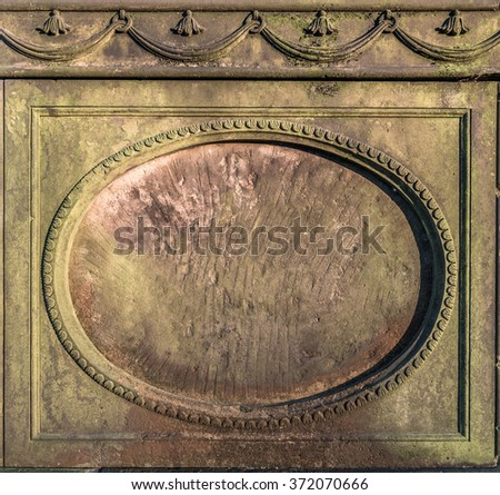 Vintage stone circular frame on an old tombstone.