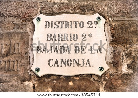 Vintage street sign in Barcelona, Spain. Old architecture detail.