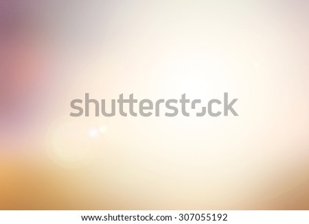 Vintage style. Abstract blurred textured background: orange and purple patterns. Blurred nature background. Sandy beach backdrop with turquoise water and bright sun light. Summer holidays concept. - stock photo