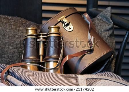 Vintage style binoculars with retro leather case - stock photo