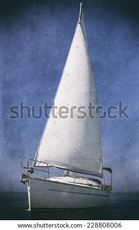 Vintage style black and white image of a sailing boat - stock photo