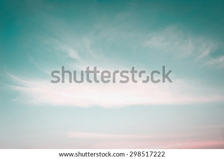 Vintage style blurred nature background of cyan blue pink sky and soft clouds on wind blowing movement on watercolor paper texture: Water colour textured paper with blurry soft retro sky on windy day  - stock photo