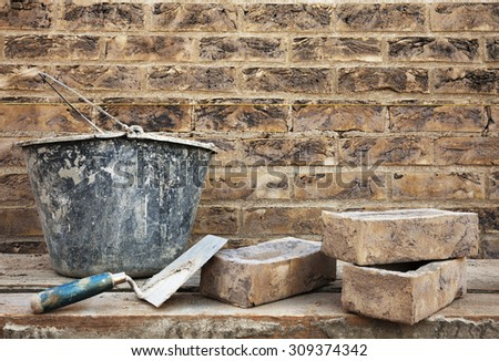 Vintage style brickwork and construction's tools. Masonry brickwork concept  - stock photo