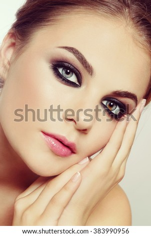 Vintage style close-up portrait of young beautiful stylish young woman with smoky eyes - stock photo