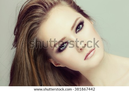 Vintage style close-up portrait of young beautiful teen girl with smoky eyes make-up