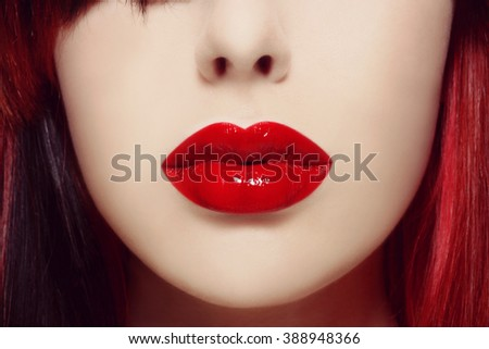 Vintage style close-up shot of beautiful woman lips covered with red lipstick - stock photo