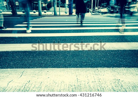 Vintage style - Crosswalk and pedestrian at modern city zebra crossing street in rainy day. Blur abstract. - stock photo