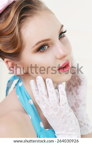 Vintage style fashion portrait of cute smiling blonde teenager girl - stock photo