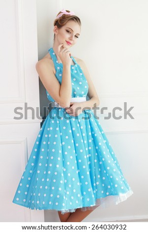 Vintage style fashion portrait of cute smiling blonde teenager girl prom