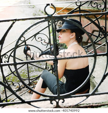 Vintage style fashion woman portrait dressed in hat with lips red colour, outdoor - stock photo