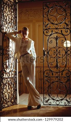 Vintage style girl posing on museum. Fashion Photo. - stock photo