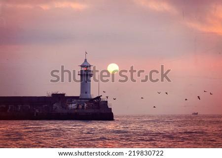 Vintage style image of lighthouse on sunrise. Yalta, Crimea, Ukraine - stock photo