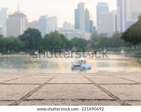 Vintage style image of urban park lake view of Bangkok city downtown business area