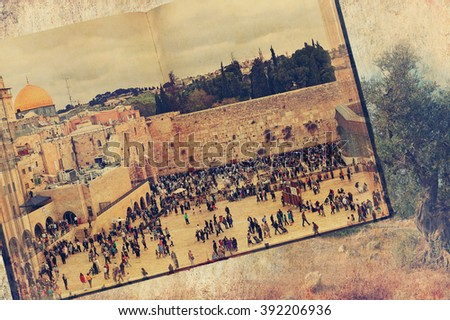 Vintage style image of Western Wall (Wailing Wall or Kotel) in Old city of Jerusalem. Conceptual holy land image. Ancient Bible landscape with old olive tree background. Texture old paper background - stock photo