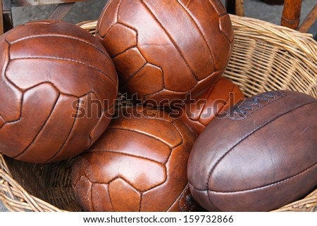 Vintage style leather balls for volleyball and rugby - stock photo