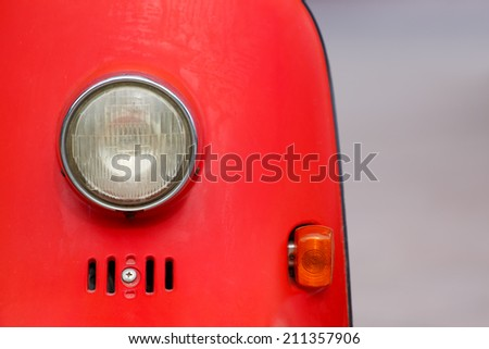 Vintage style motorcycle light with red body - stock photo